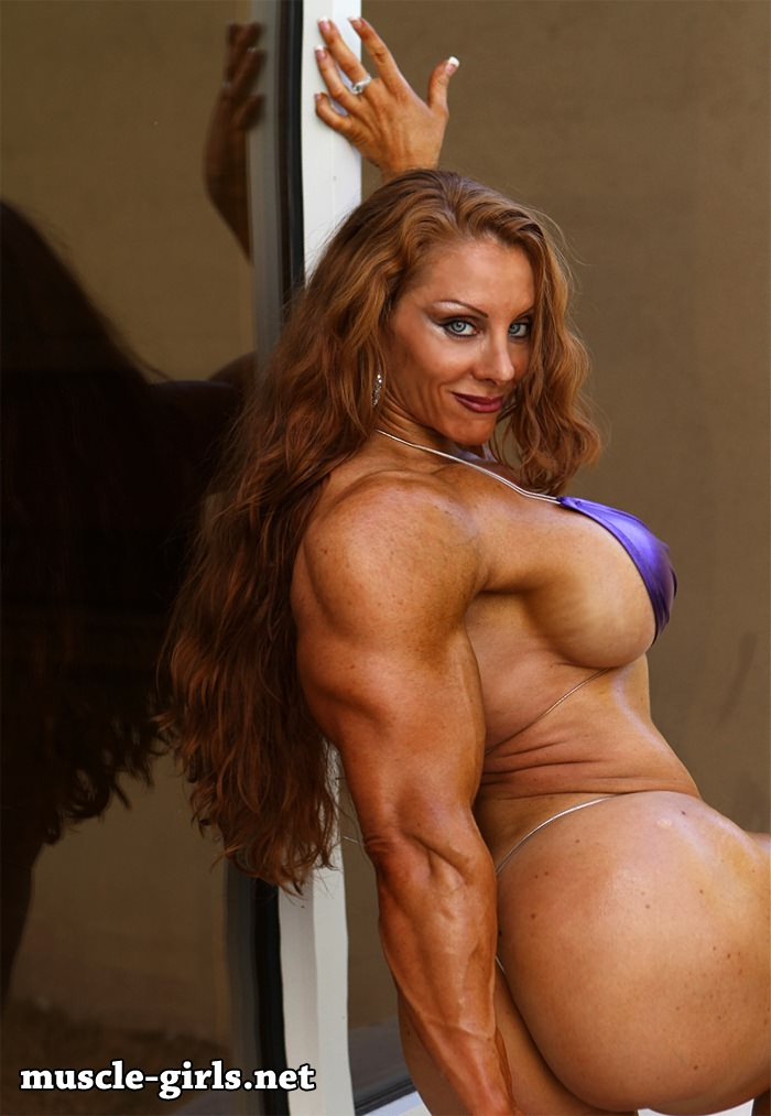 image Naked female bodybuilder shows off big biceps and boobs