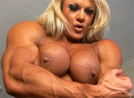 Sexy busty Female Bodybuilder flexing her huge muscles topless from ...
