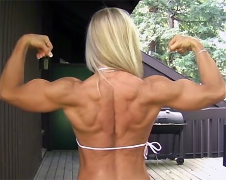 Sexy busty Fitness blonde flexing her biceps